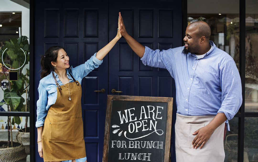business owners doing a high five